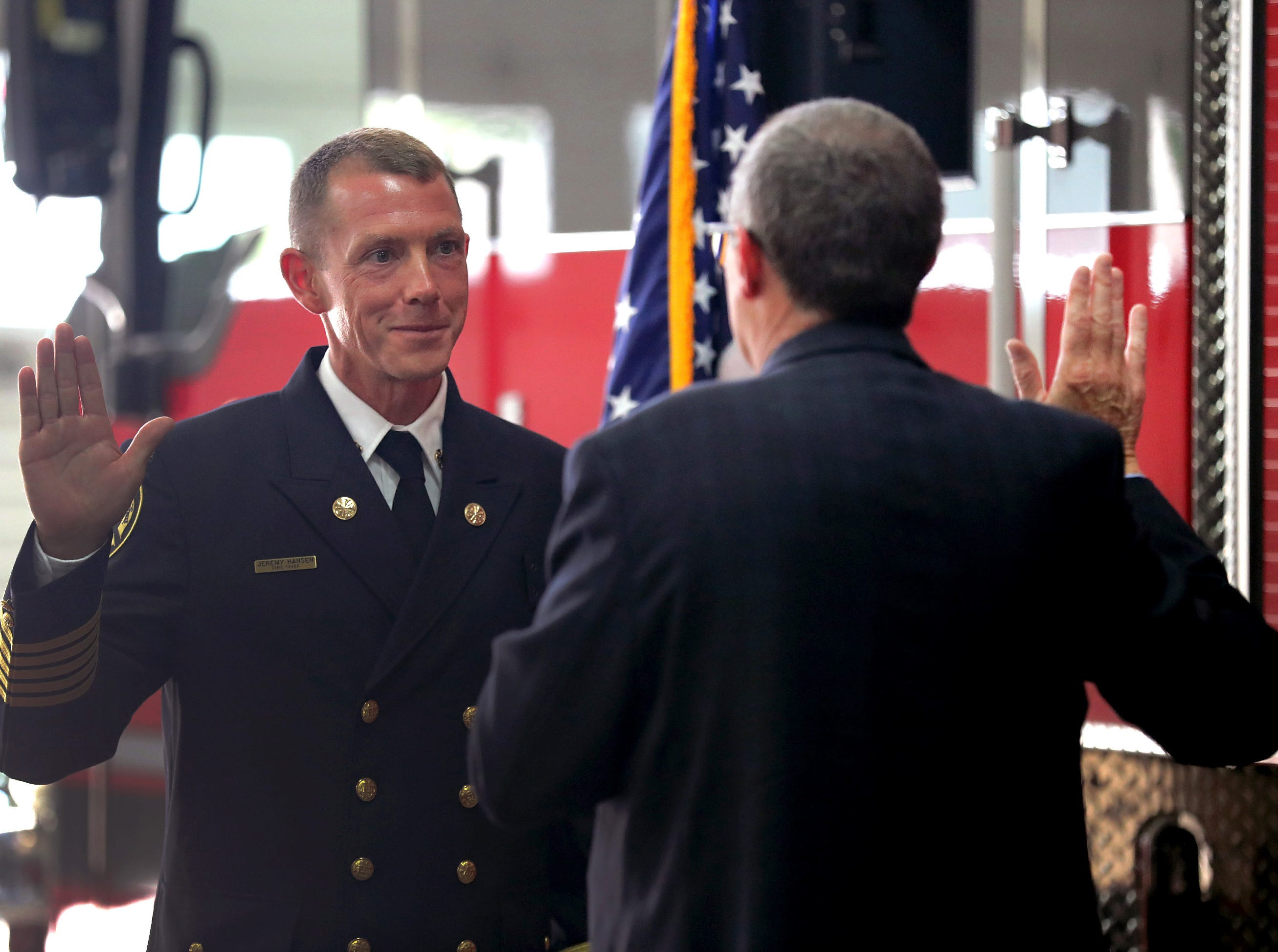 New Appleton Fire Chief Jeremy Hansen is sworn in by Appleton City Attorney James Walsh during a ceremony on Monday, July 16, 2018 at Fire Station 1 in Appleton, Wis. 