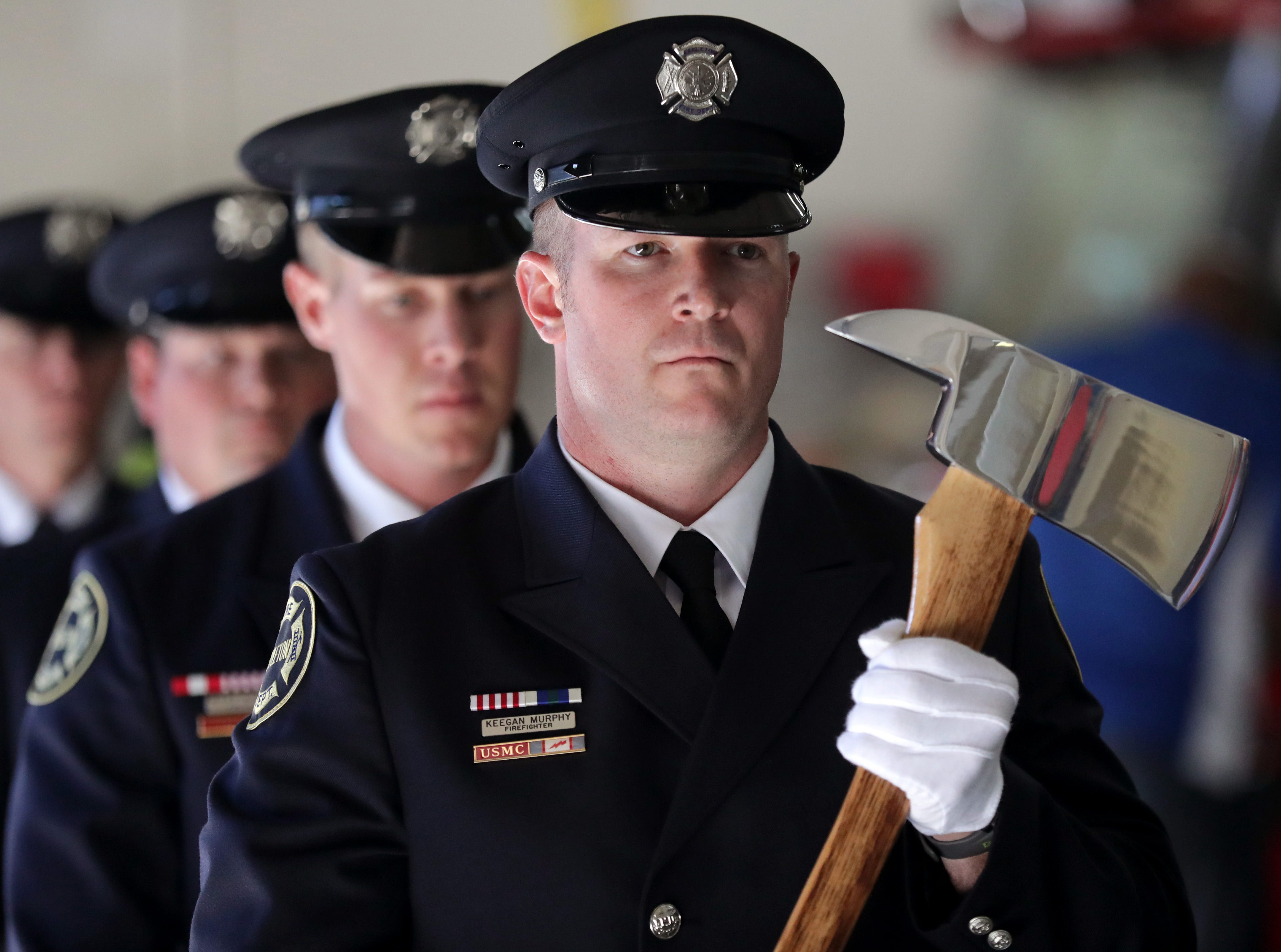 Firefighter Keegan Murphy walks with the Color Guard during a ceremony to  swear in new Fire Chief Jeremy Hansen on Monday, July 16, 2018 at Fire Station 1 in Appleton, Wis. 