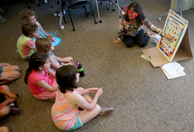 Ruth Carlson hosts a Spanish Immersion story time at the Port Orchard Library on Monday.