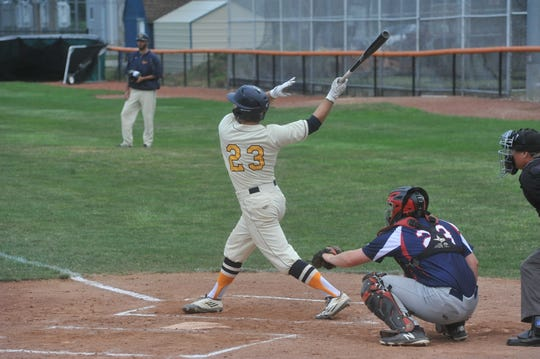 Eric Wentz swings at a pitch against the Settlers.