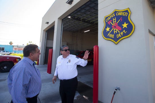 City Councilman Rudy Garza  and Fire chief Robert Rocha admire the ceramic murals and marking at Fire Station No. 18 following a mural dedication ceremony Monday, July 23, 2018.