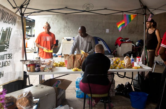 Maslow's Army, a non-profit, made up of volunteers that do outreach with people experiencing homelessness, has been coordinating the food and other refreshments at the homeless encampment off third street near the Bengals Stadium. Beginning Tuesday, the area will be cleared and people will be moved to another location on the east side. After everyone vacates, the area will be power washed.