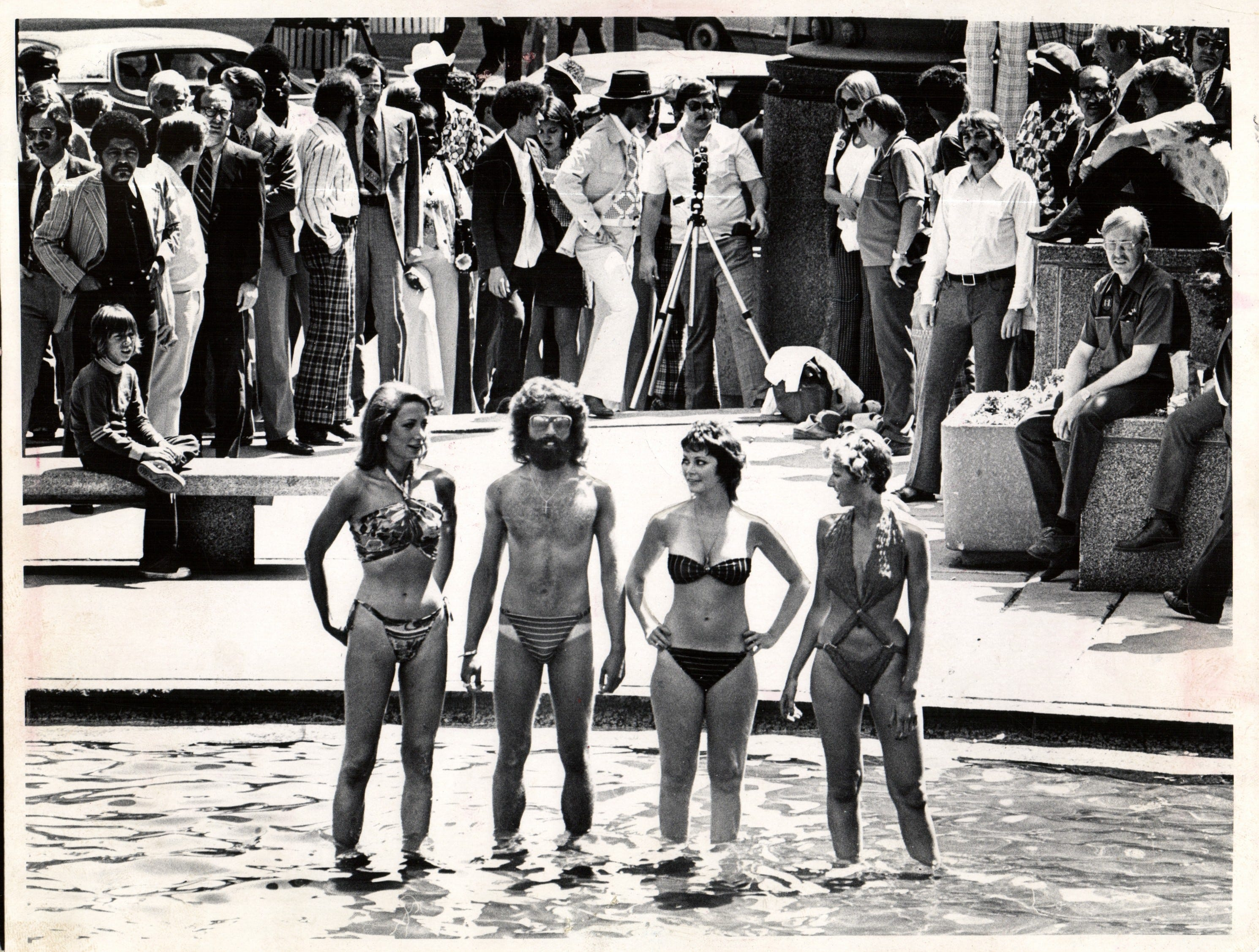 Bikini models are spotted during lunch time at Kennedy Square in 1974.