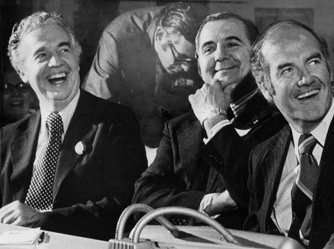 Frank Kelley, left Mayor Roman Gribbs and George McGovern share a light moment at a  labor breakfast Septmber 23, 1972.