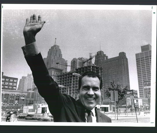Richard Nixon waves during a 1968 campaign stop in Detroit.