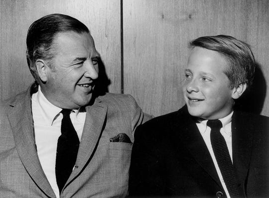 Henry Ford II is photographed with his son Edsel Ford on July 4, 1965.