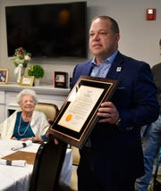"City of Rochester Hills Mayor Bryan Barnett, right, reads a proclamation, which was presented to Rosaria ""Sara"" Martinico in honor of her 108th birthday in Rochester Hills."