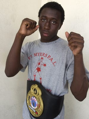 Wisner 'Fred' Desmaret  wears a championship belt he won as a Fort Myers Police Athletic League boxer in 2008.