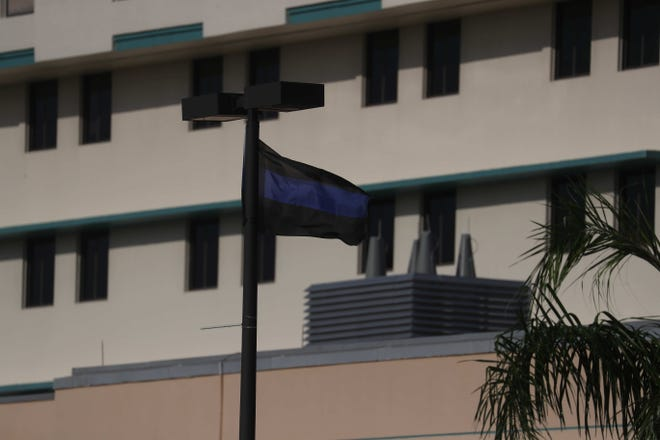 Two thin blue line flags are flying at Lee Memorial Hospital in honor of Fort Myers Police Officer Adam Jobbers-Miller. Jobbers-Miller was seriously injured in a police involved shooting at the Marathon gas station on Martin Luther King Jr. Boulevard.