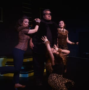 """Big Bill,'' center, is introduced in this musical piece from ""Shinbone Alley'' opening Thursday at the Third Avenue Playhouse in Sturgeon Bay. Surrounding ""Big Bill,'' played by Bill Theisen of Iowa, are Carmen Risi of Kenosha, left, as ""Lillian,'' Jennifer Harlee Mitchell of Chicago, bottom, as ""Phyllis,'' and Katie Schwaber of Chicago as ""Gladys.''"
