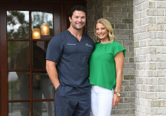 Dr. Rich Constantine poses with his wife Trish at his Greenville dentist office Monday, July 23, 2018. Constantine posted a dance challenge video on Facebook last week that went viral and has been viewed over 45 million times.