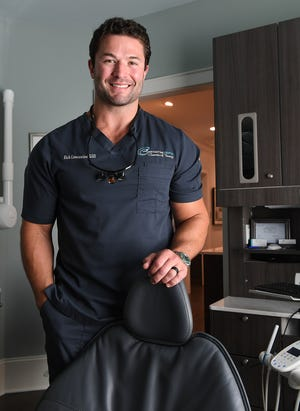 Dr. Rich Constantine poses in his Greenville dentist office Monday, July 23, 2018. Constantine posted a dance challenge video on Facebook last week that went viral and has been viewed over 45 million times.