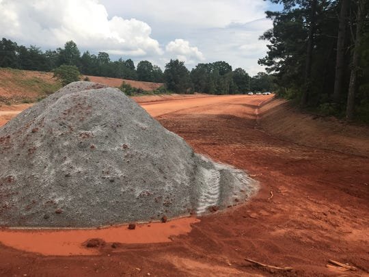 Construction on the State 153 extension, near its intersection with Saluda Dam Road.