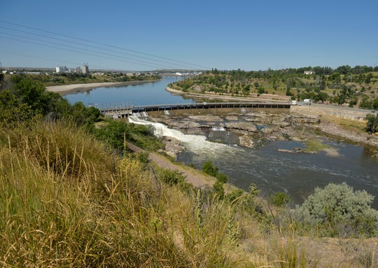 Water is no longer races over the top of Black Eagle Dam leaving the falls below the dam mostly dry after this year's wet spring. Northwestern Energy has allowed the water level above Black Eagle Dam to drop so that they can make repairs to the face of the dam.