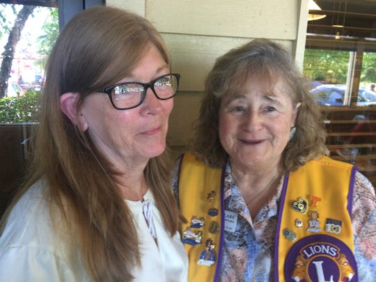 Deb Hill (left) and Clare Crawford share a moment during a reunion at the Knox North Lions Club.
