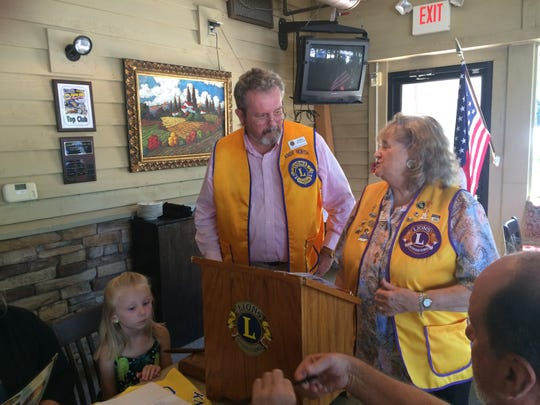 Knox North Lions Club president Greg Householder (left) and past district governor Clare Crawford address business at a meeting.