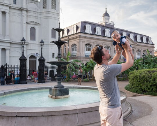 Tristan Yeats holds up daughter Harper, 3 months, in Jackson Square in New Orleans. The family is on an epic road trip to visit all 50 United States in Harper's first six months. They spent a long weekend in Louisiana.