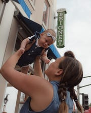 Cindy Lim holds daughter Harper Yeats, 3 months, in front of Cafe Beignet in New Orleans. The family is on an epic road trip to visit it all 50 United States by the time Harper turns 6 months. Louisiana is the baby's 19th state to visit.