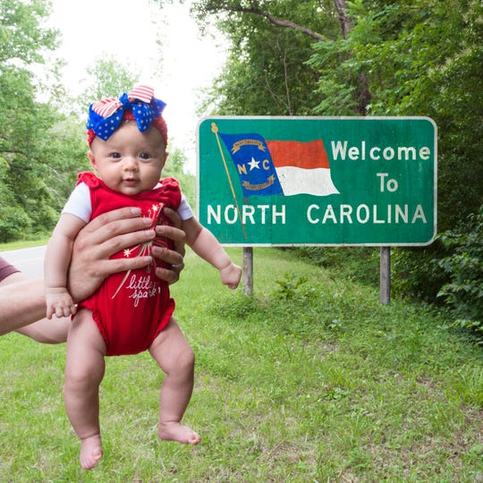Harper Yeats is on an epic road trip to visit it all 50 United States with her family by the time she turns 6 months. Her parents snap a photo of her with a state sign to mark each one. North Carolina was Harper's 13th state to visit. Louisiana was 19th.