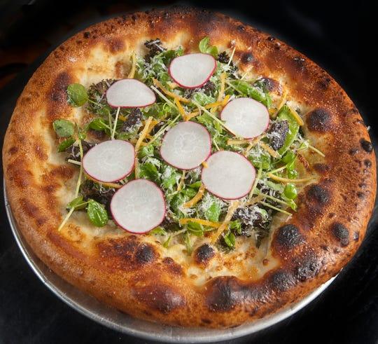 bar Vetti's Spring Veggie Pizza is topped with mascarpone cheese, kale, peas, radish, preserved Meyer lemon and pecorino cheese. July 10, 2018