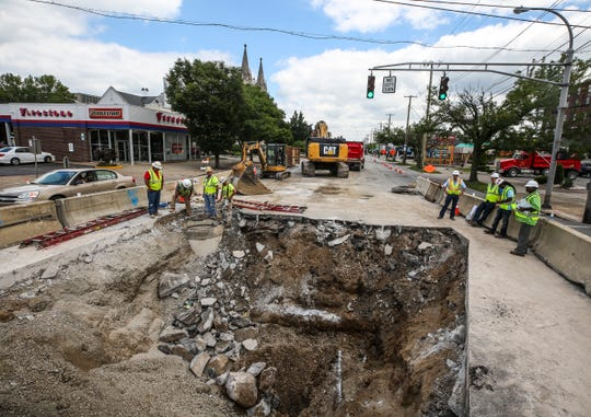 Work continues on repairing a sewer pipe cave-in on Broadway near South Preston Street. The cave-in was reported to Metropolitan Sewer District on July 20.