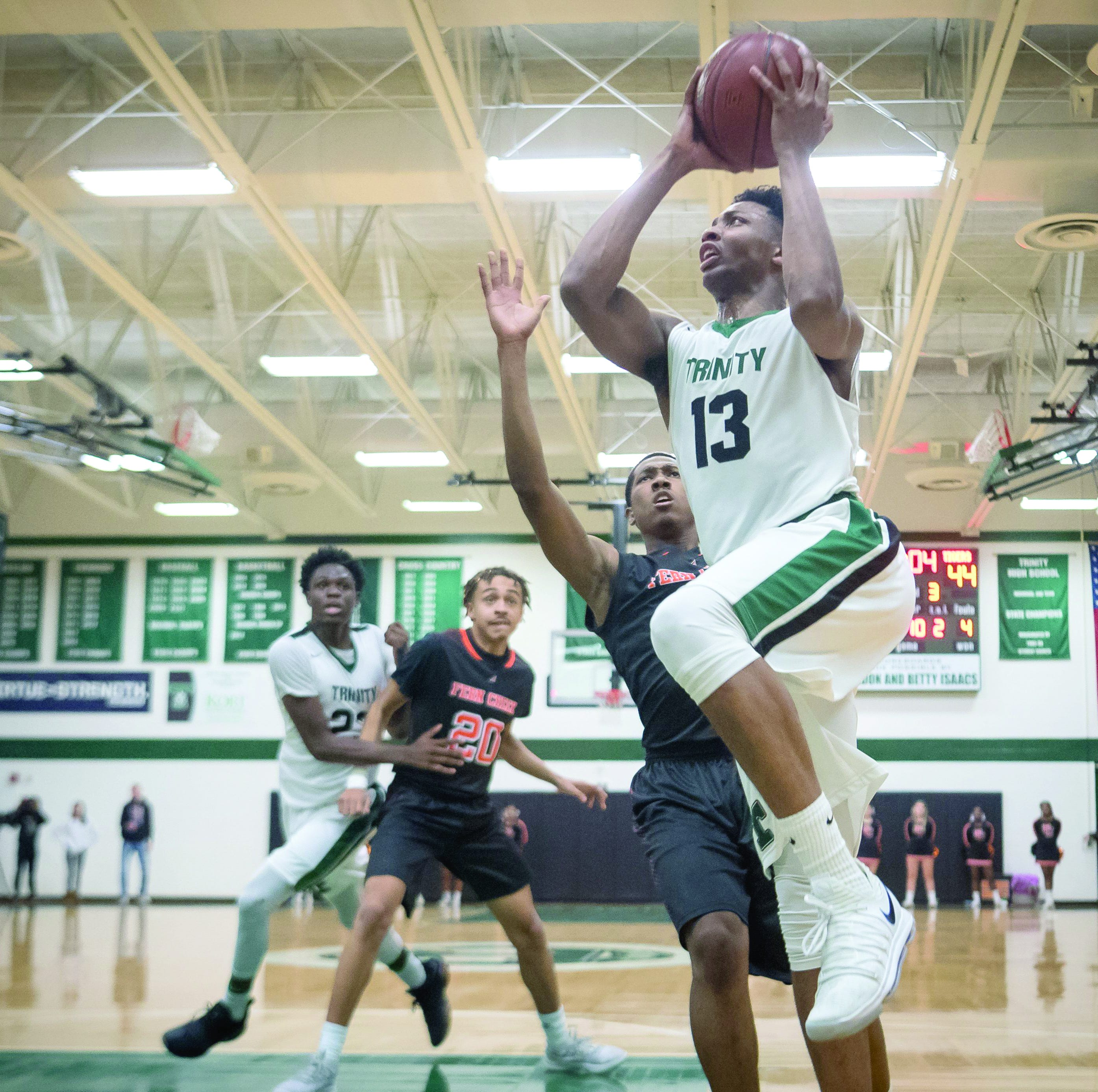 Trinity basketball player David Johnson commits to Louisville — again