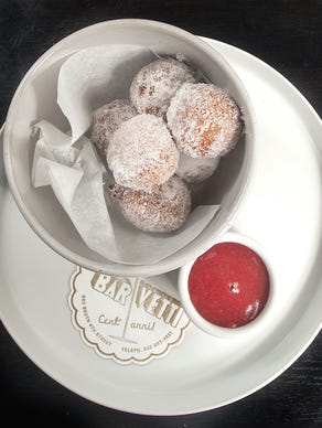 bar Vetti's Ricotta Bomboloni are Italian donut spheres dusted with sugar and served with strawberry jam. July 10, 2018