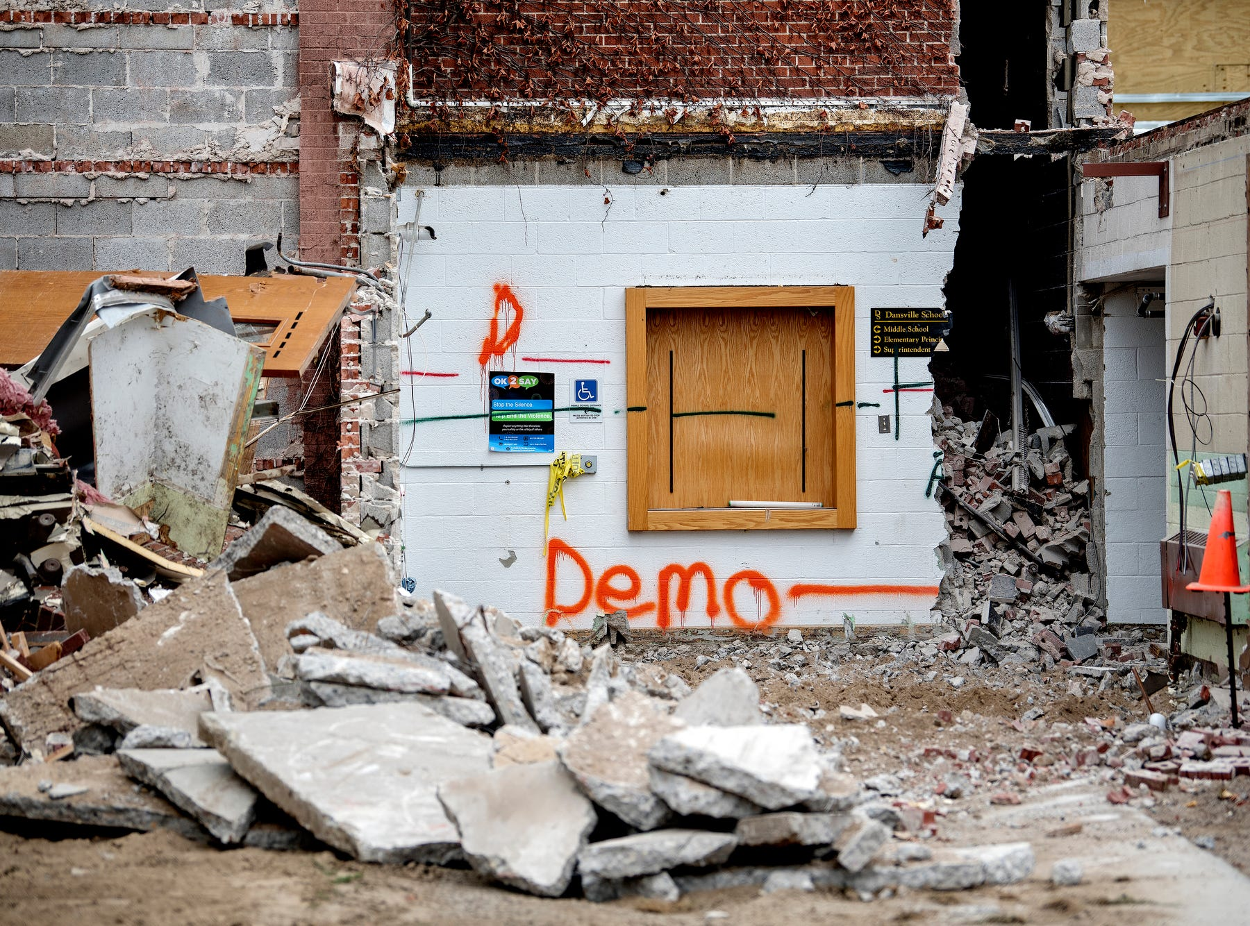 An inside area is exposed as crews begin to demolish the old Dansville Middle School on Monday, July 23, 2018, in Dansville. The building is being razed as part of the district's 2016 millage, which is funding the demolition as well as the construction of a new high school.