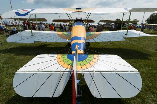 """This replica of the 100th Sopwith Camel built by the Ruston and Lincoln Co. is shown at the 2018 Experimental Aircraft Association AirVenture in Oshkosh. The World War I-era plane is shown with British Royal Air Force markings and a paint scheme inspired by the Egyptian winged god """"Behudet""""."""