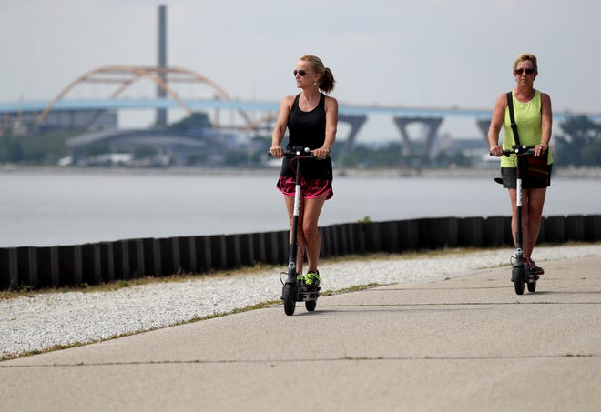 Carolyn Gambill (left), of Milwaukee and her sister Jeannie Cleveland, visiting from Boulder, Colorado and go riding around the lakefront on Bird scooters near Veterans Park in Milwaukee. The City of Milwaukee took legal action against Santa Monica, Calif.-based Bird Rides Inc., the company responsible for dropping off 100 motorized scooters in the Historic Third Ward, Walker's Point and other parts of downtown late last month.