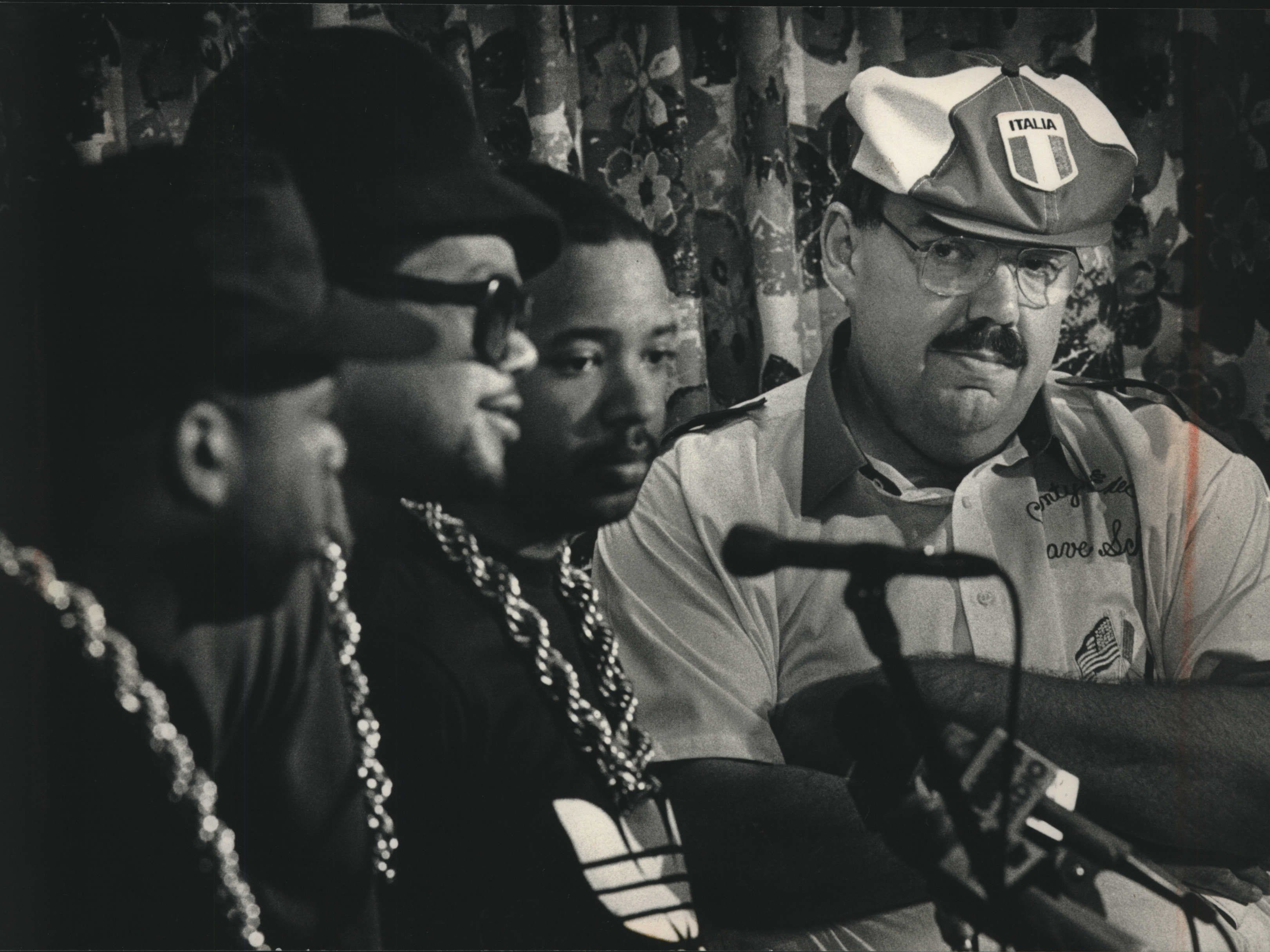 "Rap titans Run-D.M.C. join forces with  County Executive David F. Schulz at a news conference at the Martin Luther King Jr. Center to promote ""Work Works,"" a campaign that stresses the importance of working, on Jul;y 21, 1988. This photo was published in the July 22, 1988, Milwaukee Sentinel."