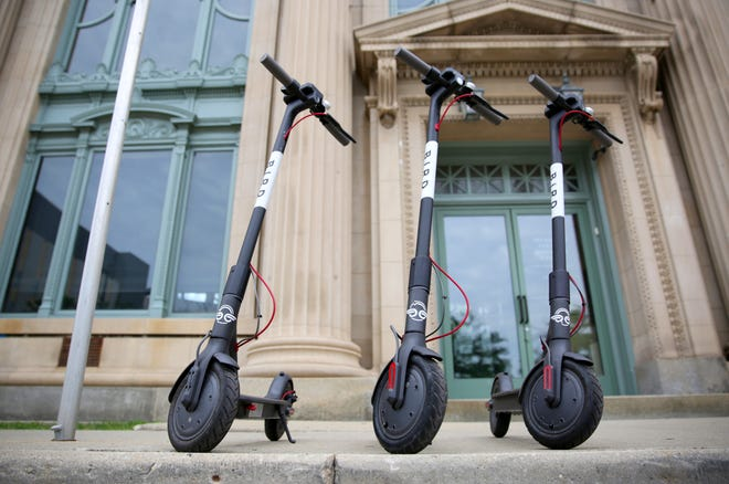 A collection of Bird scooters wait to be rented near the Milwaukee County historical center at 910 North Old World Third Street. The City of Milwaukee took legal action against Santa Monica, Calif.-based Bird Rides Inc., the company responsible for dropping off 100 motorized scooters in the Historic Third Ward, Walker's Point and other parts of downtown late last month.