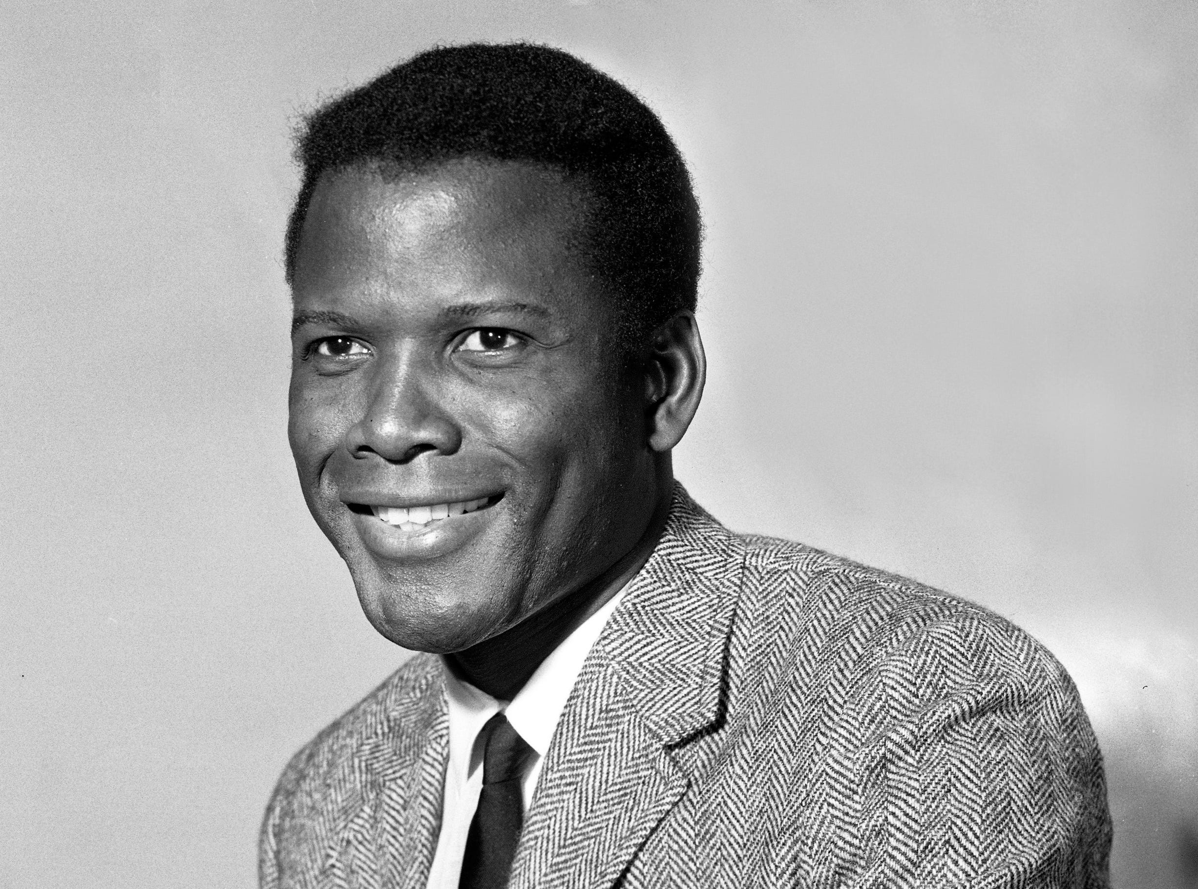 "Actor Sidney Poitier stops by the Journal Co. studio for a portrait and interview on Sept. 19, 1963. Poitier was in Milwaukee to promote his movie ""Lilies of the Field""; a year later, he won the Academy Award for best actor for his performance. This photo was published in the Sept. 19, 1963, Milwaukee Journal."