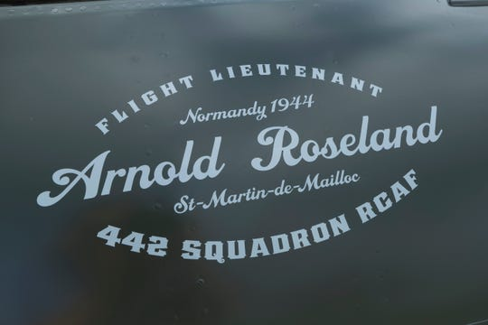 The name of Arnold Roseland, a Canadian World War II fighter pilot, is shown on a reproduction of a Royal Canadian Air Force Spitfire at the Experimental Aircraft Association AirVenture in Oshkosh.