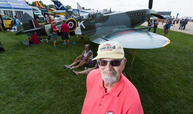 Ron Roseland-Barnes is shown with a reproduction of the Royal Canadian Air Force Spitfire his father flew in World War II at the 2018 Experimental Aircraft Association AirVenture in Oshkosh.