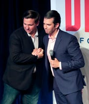 Donald Trump Jr., right, greets Florida gubernatorial candidate U.S. Rep. Ron DeSantis at a campaign rally Wednesday, July 18, 2018, in Orlando.