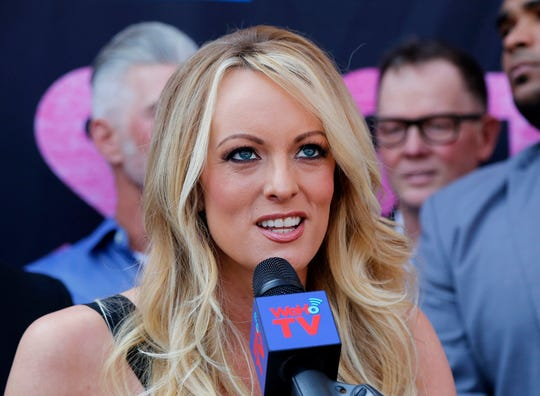 FILE - In this May 23, 2018 file photo, porn actress Stormy Daniels speaks during a ceremony for her receiving a City Proclamation and Key to the City in West Hollywood, Calif. Daniels is set to return to Ohio next month, three weeks after her arrest at a Columbus strip club on charges that were later dropped. (AP Photo/Ringo H.W. Chiu, File)