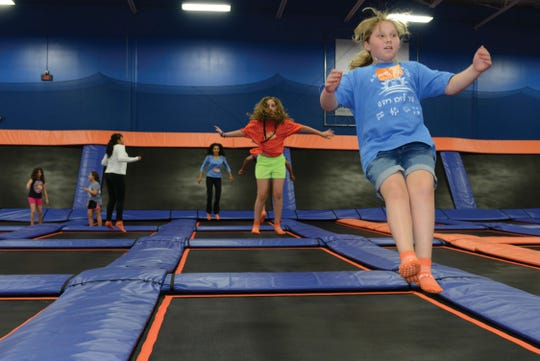 128241 PINE BROOK, NJ 06/25/2014 New Jersey's first Sky Zone trampoline amusement center. (Right) Sarah Cohen, 11, of West Orange. MICHAEL KARAS / STAFF PHOTOGRAPHER