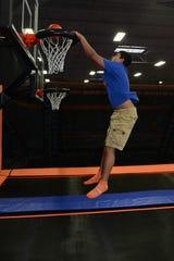 128241 PINE BROOK, NJ 06/25/2014 New Jersey's first Sky Zone trampoline amusement center. Tristan Henningsen, 15, of Hardyston, dunks a basketball. MICHAEL KARAS / STAFF PHOTOGRAPHER