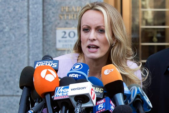 In this April 16, 2018, file photo, adult film actress Stormy Daniels speaks outside federal court, in New York.