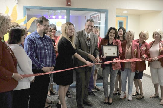 A ribbon cutting recently took place at the new studios of KSJE, 4601 College Blvd.