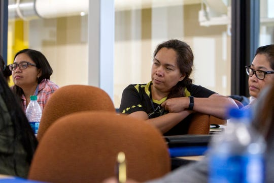 """A group of science, technology, engineering, and mathematics, STEM, teachers listen to a presentation Monday during """"Carbon Rocks! Teachers Workshop on Benefits of Coal"""" hosted by Navajo Transitional Energy Company at San Juan College School of Energy in Farmington."""