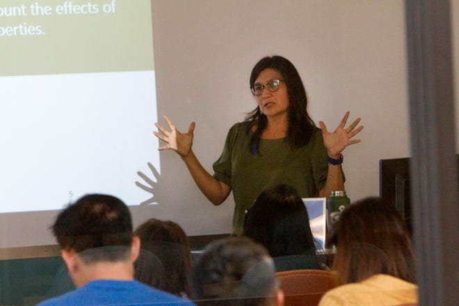 "Terri Laneman-Austin with Bisti Fuels, gives a presentation to a group of science, technology, engineering, and mathematics teachers on Monday during the ""Carbon Rocks! Teachers Workshop on Benefits of Coal"" hosted by Navajo Transitional Energy Company at San Juan College School of Energy in Farmington."