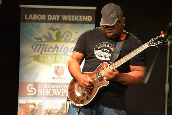 Deux plays guitar for IS Evolution at NextWave Media Labs in Troy during auditions for the Michigan State Fair Superstars competition.