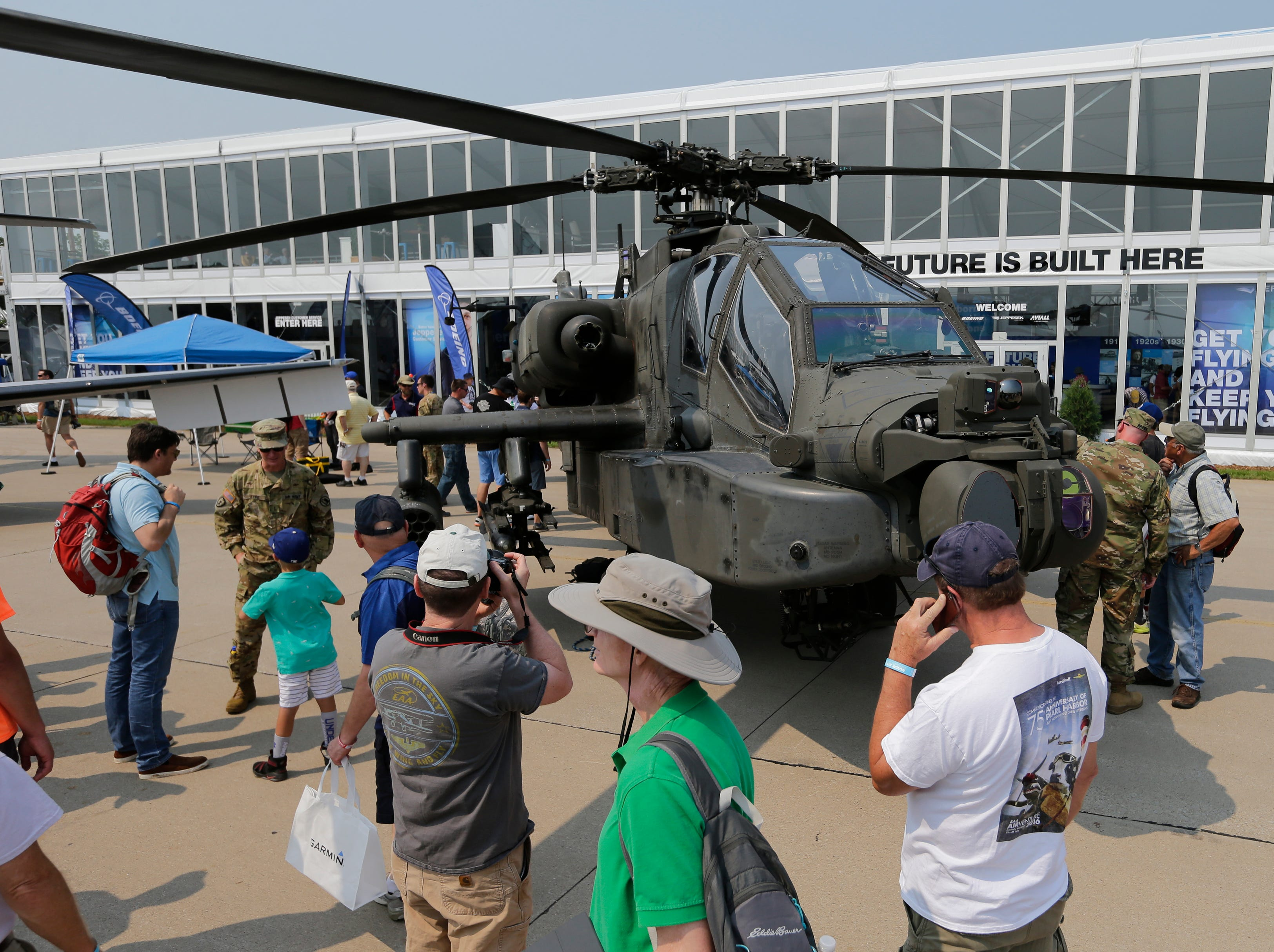 The Apache helicopter drew a crowd during the first day.  The first day of AirVenture 2018 opened on July 23, 2018.  Thousands of people will pass through the gates of AirVenture. Joe Sienkiewicz/USA Today NETWORK-Wisconsin