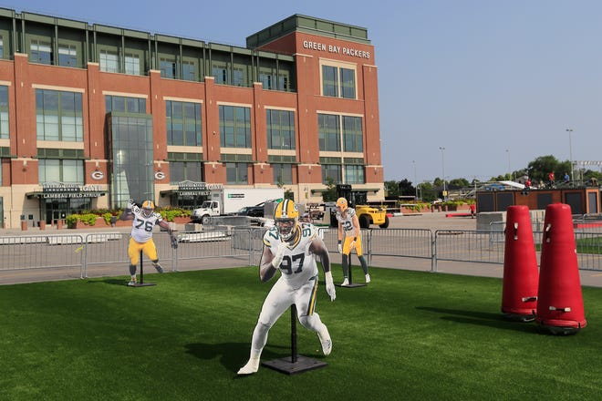 Setup work for the Packers Experience continues outside Lambeau Field on Monday, July 23, 2018 in Green Bay, Wis. The Packers Experience is free to attend and will be open for fans from July 26-29.Adam Wesley/USA TODAY NETWORK-Wisconsin