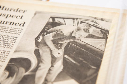A photo from 1984 shows Richard Martin exiting a police vehicle after he was arrested in the robbery and murder of Romola Holm and the rape of another woman.