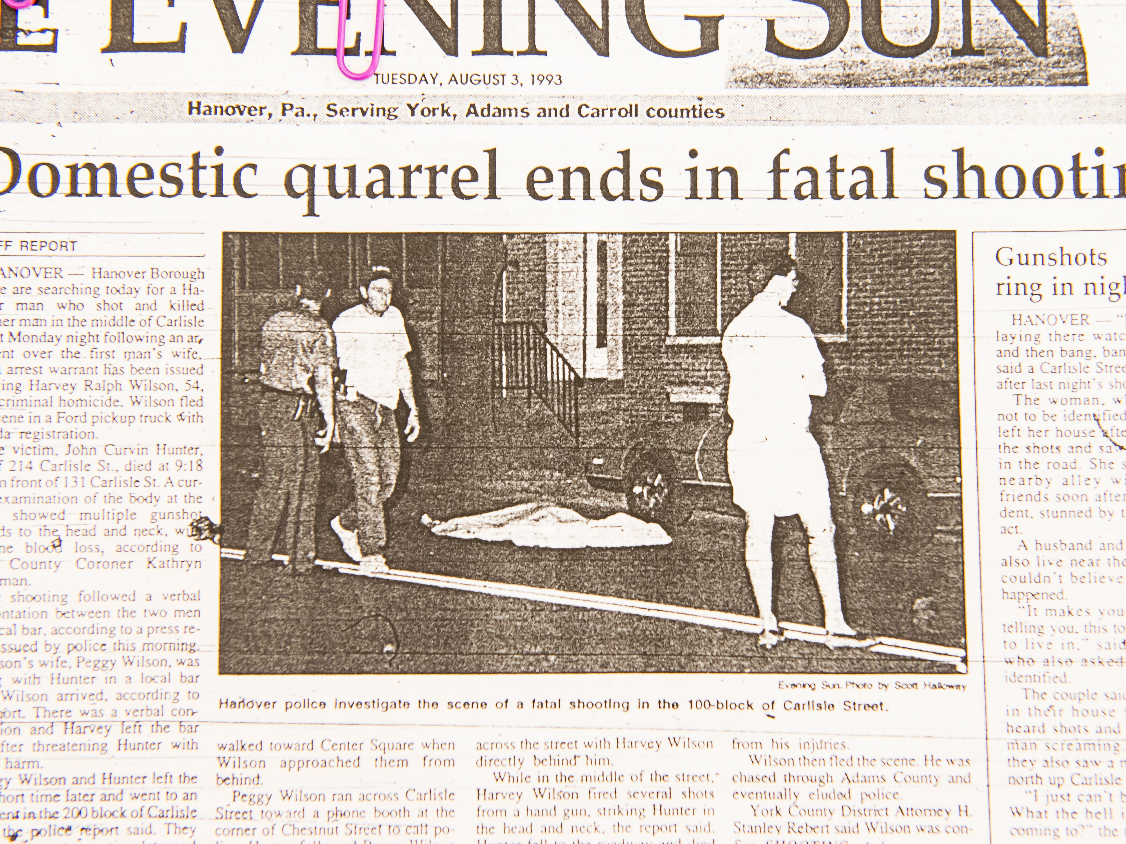 A newspaper clipping from 1993 talks about the shooting death of John Hunter on Carlisle Street.
