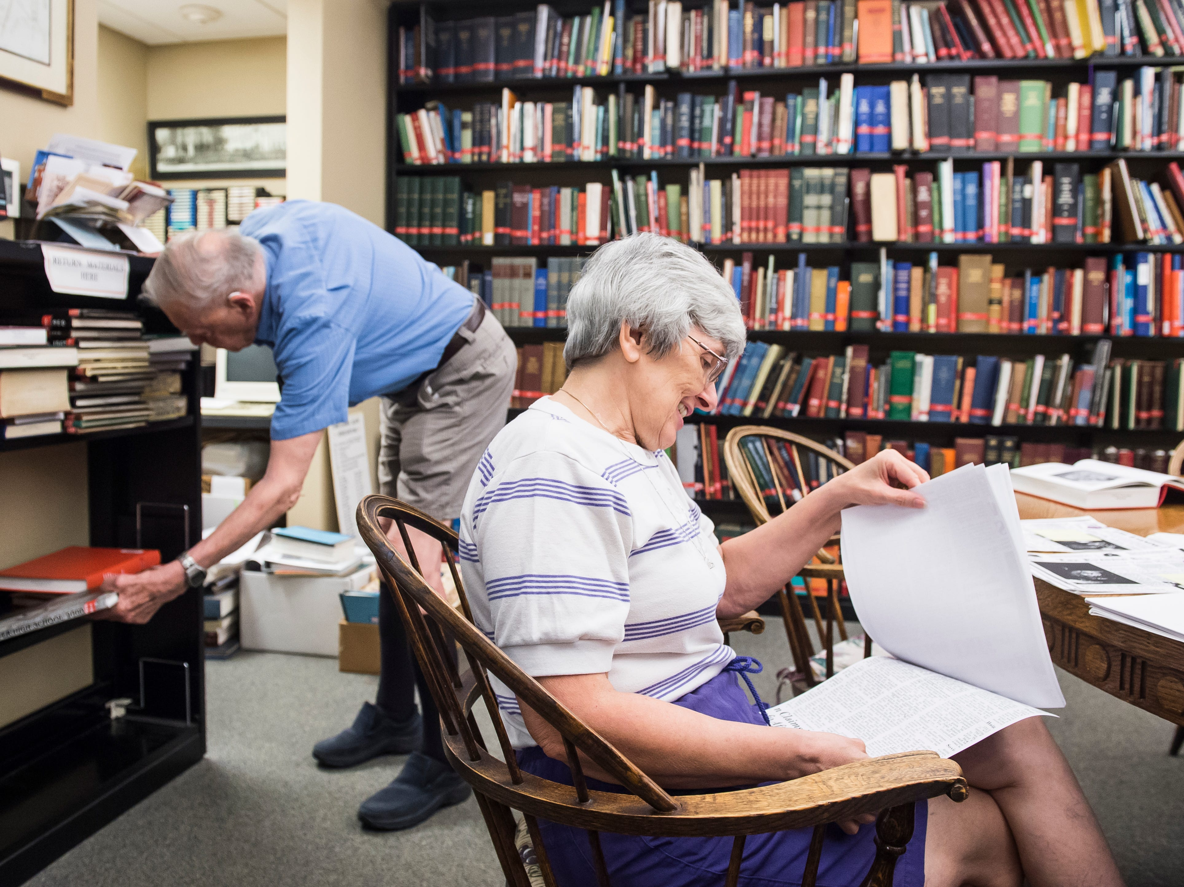 Wendy Bish-McGrew and her husband, John McGrew, conduct research in the Pennsylvania Room at Guthrie Memorial Library in Hanover on July 20, 2018. In 2009, Bish-McGrew began documenting murders that occurred in the Hanover postal code, dating back as far as 1752.