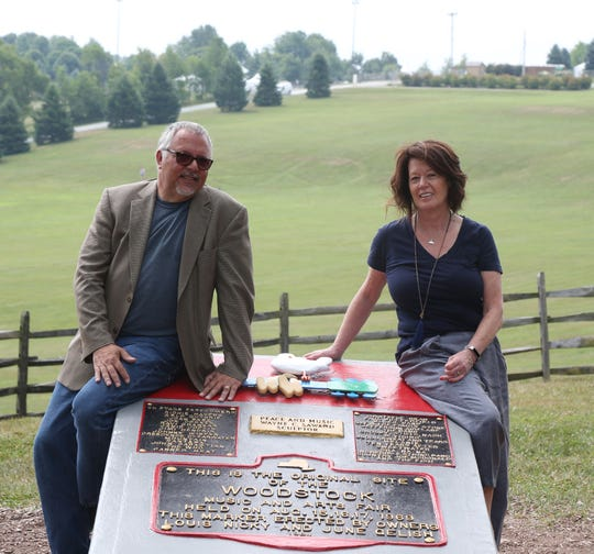From left, museum director, Wade Lawrence and Bethel Woods CEO, Darlene Fedun beside the field where Woodstock took place at Bethel Woods Center for the Arts on July 17, 2018.